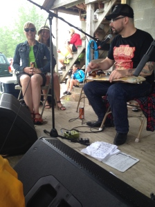 The significant other of the skeptical cardiologist (SOSC) and friend enjoying the bluesy slide guitar work of White Trash Blues Revival at the McBaine stop along the KT trail at the Pedaler's Jamboree